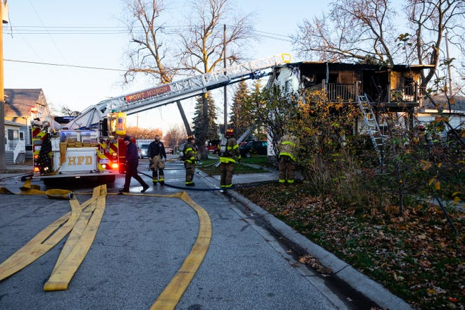 Firefighters respond to a structure fire on 12th Street Thursday morning, Nov. 12, 2020, in Port Huron.