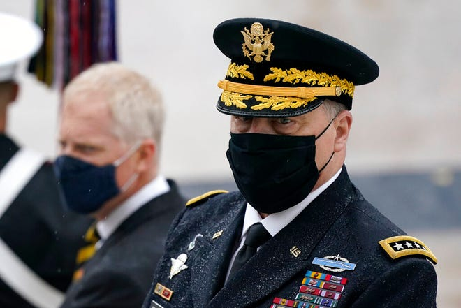 Joint Chiefs Chairman Gen. Mark Milley attends a Veterans Day wreath laying ceremony led by President Donald Trump at the Tomb of the Unknown Soldier at Arlington National Cemetery in Arlington, Va., Wednesday, Nov. 11, 2020. (AP Photo/Patrick Semansky)