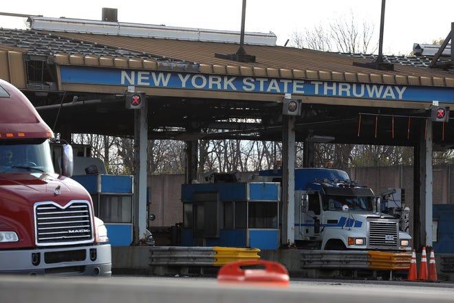 Trucks and other vehicles go through the New York State Thruway Williamsville Toll Barrier, Nov. 12, 2020.