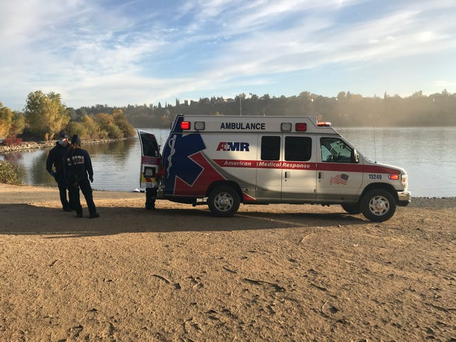 A man who was rescued from the Sacramento River after jumping off the Highway 44 bridge is put in an ambulance on Thursday morning, Nov. 12, 2020.
