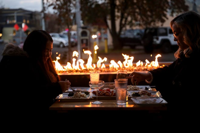 Diners eat on the heated patio at Masonry Grill in Salem on Wednesday, Nov. 11, 2020. The restaurant has had to limit seating even outdoors due to COVID-19 restrictions.