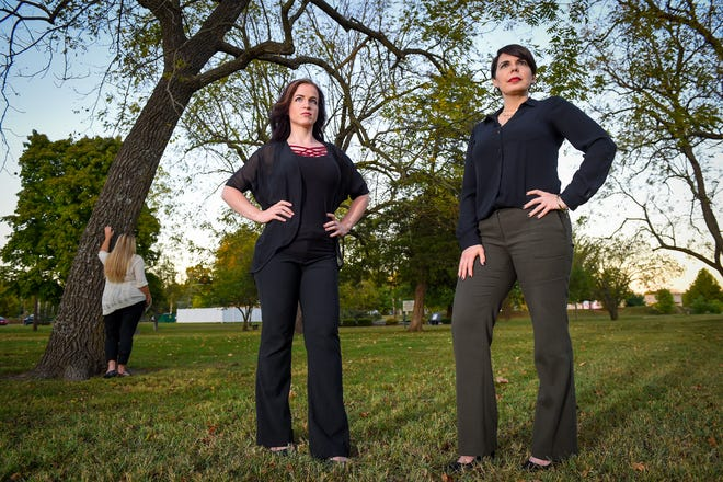 Survivors of domestic violence, Shannon Joy, center, and Janice Thompson, right, met with another survivor of domestic violence near the Victims' Memorial Garden in Phelps Grove Park in Springfield, Missouri.
