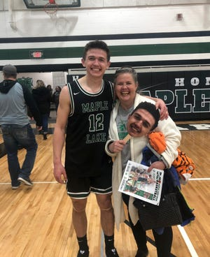 Jackson Berscheid smiles with his mom Andrea on senior night at Maple Lake High School Friday, Feb. 28, 2020. Berscheid is a freshman basketball player at St. John's and recently was diagnosed with Hodgkins Lymphoma.