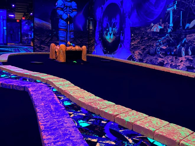 A look at one of the 18 holes at Space Adventure Glow in the Dark Mini Golf in the Palisades Center.