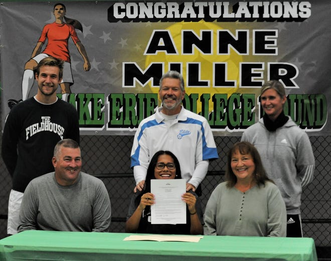 Tri-Valley senior Anne Miller (seated, center) signed her letter of intent to play soccer for Division II Lake Erie College on Wednesday. Anne was adopted by her parents, Jerry and Sandra Miller (seated), and others pictured (standing, from left to right) are Will Hess, Steve Malone and Emily Reilly.