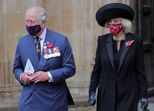 Prince Charles and his wife, Duchess Camilla of Cornwall, at Westminster Abbey for ceremony marking the centenary of the burial of the Unknown Warrior, on Nov. 11, 2020.
