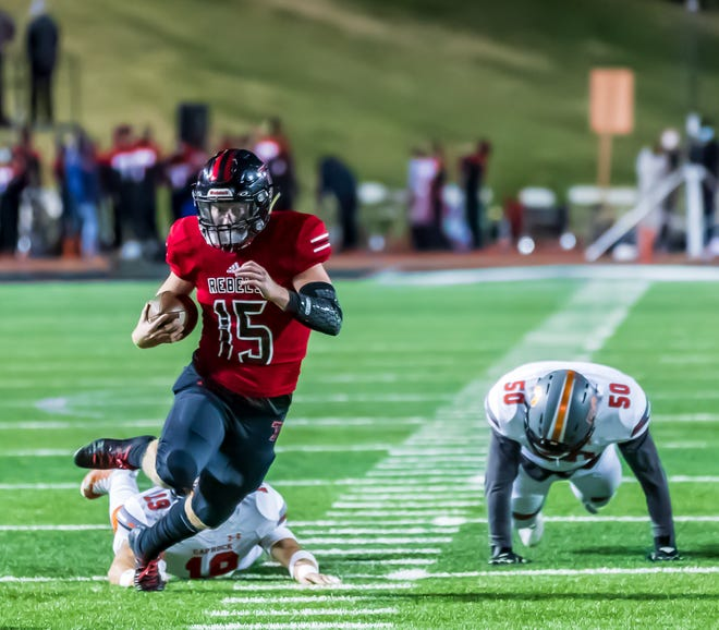 Tascosa's BT Daniel heads upfield for yardage in Thursday night's District 2-5A Division I game against Caprock at Dick Bivins Stadium. Daniel led the Rebels with 101 yards rushing and a touchdown on 14 carries as Tascosa stayed undefeated in district with a 32-13 win.