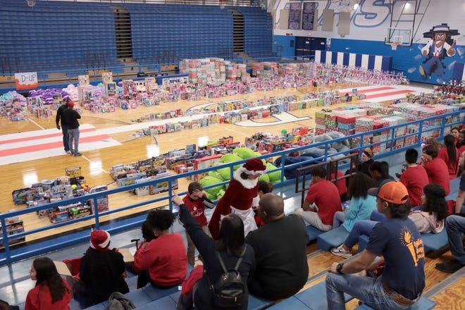 Over 3000 toys were ready for giving at a previous Northside Toy Drive distribution at Palo Duro High School. [Neil Starkey / For the Amarillo Globe-News]