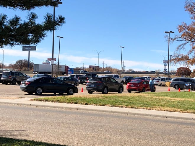 Cars waiting in line to participate in rapid COVID-19 testing provided by the Texas Education Agency at the Amarillo ISD Education Support Center.