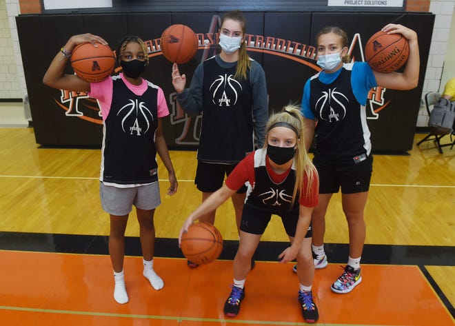 Ames High girls' basketball seniors (from left) Brooke Spraggins, Ashley Iiams, Caroline Waite, and Leah Tietjens are excited for a shot at state in 2020-2021. Spraggins is out with an ACL injury, but will cheer on her teammates should they get the chance to make a state run. The start of the season is on hold after the school switched back to 100-percent remote learning due to the rising COVID-19 positivity rate in the community.
