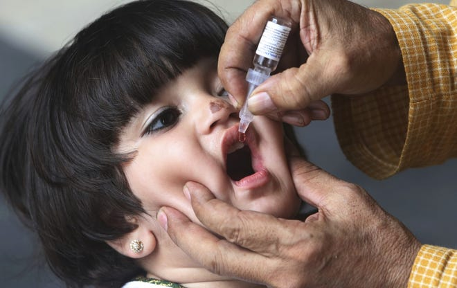 Child being immunized with the polio vaccine.