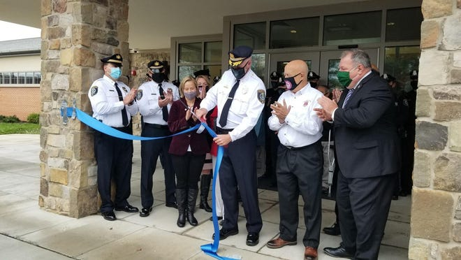 Warrington police Chief Dan Freil, center, cuts the ribbon on the township's new police station Friday morning with state Sen. Maria Collette, D-12, left, Supervisor Chairman Fred Gaines and state Rep. Todd Polinchock, R-144.