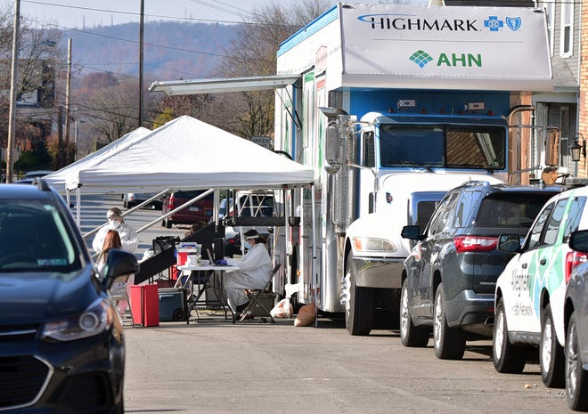 The Allegheny Health Network set up a mobile COVID clinic Friday on Clay Street in Rochester, outside Second Baptist Church.