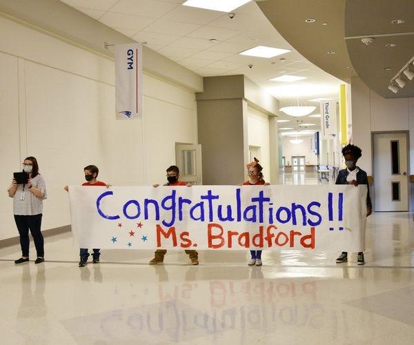 Students greeting Principal Bradford