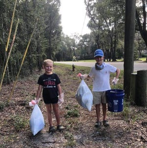 Kinley and Bryer Daley help clean up Jasper County by participating in the Grab a Bucket Challenge. The challenge asked individuals to grab a blue bucket and fill it with litter.
