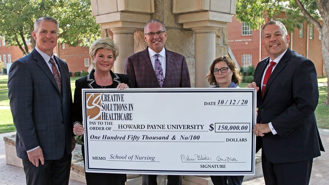 Creative Solutions in Healthcare recently donated $150,000 to support nursing at HPU. Pictured at the check presentation are Dr. Dale Meinecke, vice president for development at HPU; Malisa Blake, executive vice president of Creative Solutions in Healthcare; Gary Blake, president of Creative Solutions in Healthcare; Dr. Nina Ouimette, dean of HPU's School of Nursing; and Dr. Cory Hines, HPU president.