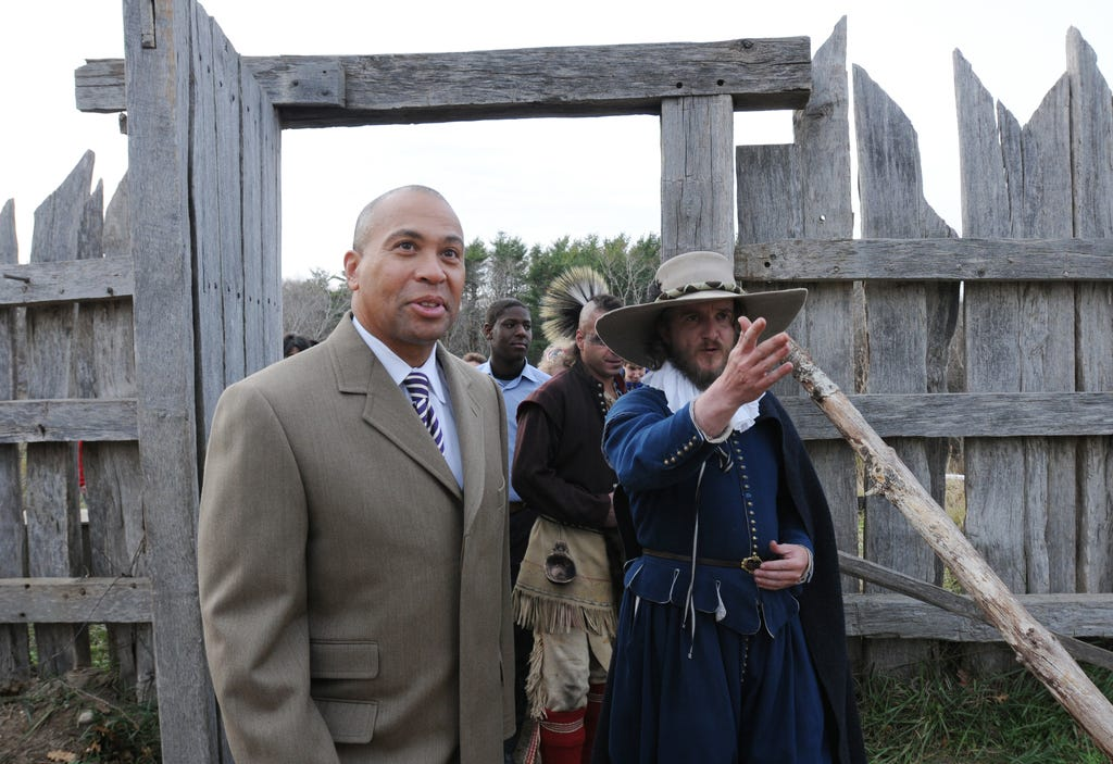 Former Massachusetts Gov. Deval Patrick meets with Plimoth Patuxet living museum interpreter acting as Gov. William Bradford on Nov. 13, 2011. The museum includes a Pilgrim village circa 1628 and a re-creation of a 17th-century Wampanoag coastal home.