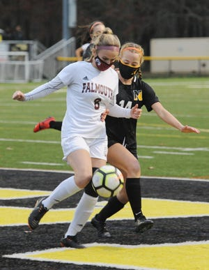 """Falmouth's Abigail Roman, left, and Nauset's Ella McGrath go after a ball in the first quarter of the Cape and Islands League Atlantic Division girls soccer semifinal in North Eastham. McGrath scored the game-winning goal in sudden-death overtime. """"I didn't even know I was the one who hit it in until everybody came running out to me,"""" she said."""