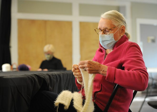 Sally Churchill, of Bass River, works on a scarf Wednesday afternoon at the Cultural Center of Cape Cod. The Bass River Knitters meet weekly and sell some of their items to raise money for the center.