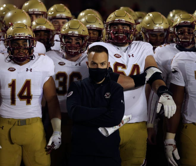 Boston College head coach Jeff Hafley and his team wait to take the field at the start of their game against Virginia Tech on Oct. 17.