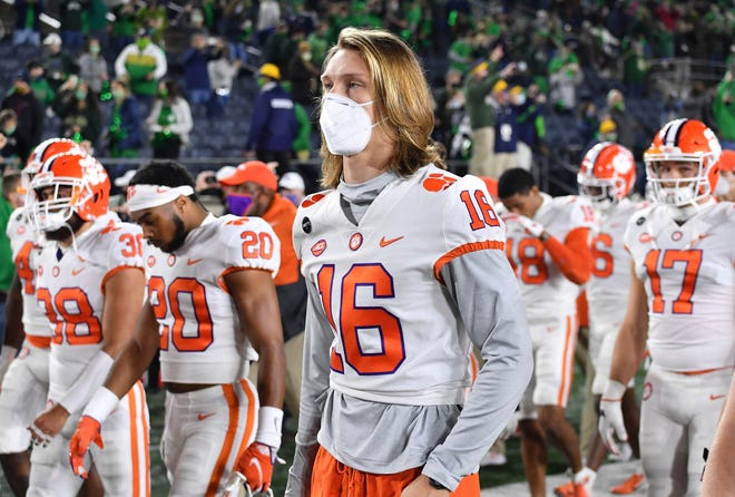 Clemson quarterback Trevor Lawrence (16) leaves the field with his teammates after Clemson lost to Notre Dame 47-40 in two overtimes last Saturday in South Bend, Ind.