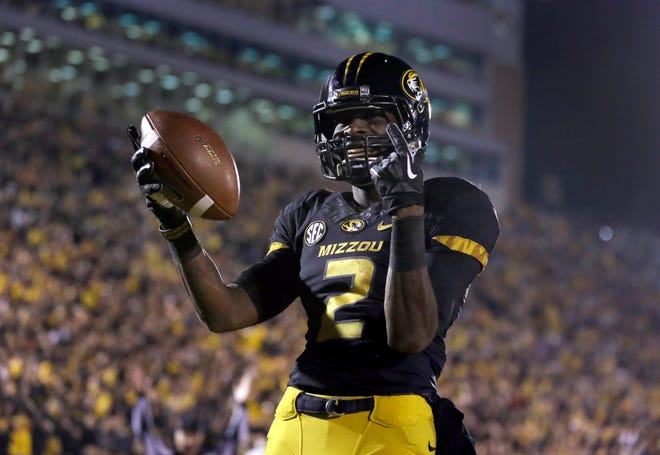 Missouri wide receiver L'Damian Washington celebrates after catching a touchdown pass during a game against Tennessee on Nov. 2, 2013, at Faurot Field.