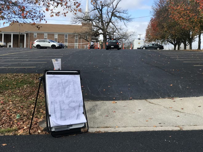 A sign marks the entrance to a drive-through COVID test site at Memorial Baptist Church on Monday, Nov. 9.