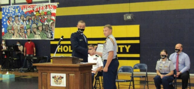 Cadet Battalion Commander presents 2nd Lt Chris Steverson with a Blue Devil Coin and Certificate of Appreciation
