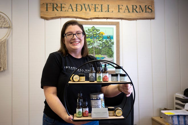 Jammie Treadwell holds up their new line of CBD products at Treadwell Farms in Umatilla. [Cindy Peterson/Correspondent]