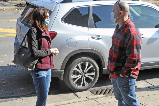Joy Vura and Josh Herncane speak outside in downtown Wooster wearing their masks. Gov. Mike DeWine and health officials are recommending Ohioans wear masks to help slow the spread of COVID-19. Ohio health officials reported 7, 715 new cases on Saturday.