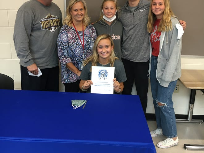 Chippewa's Allison Henegar celebrates signing with Tiffin to run cross country and track in college. Also pictured (left to right, back row): Parents Don Henegar and Mary Henegar; and siblings Ann Henegar, Charlie Henegar and Abby Henegar.