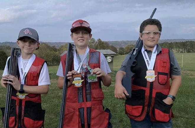 Sion Christan Academy copeditive shooters Bryant Downing, left, Taylor Sims, center, and  Alex Sanmiguel, right, brought home honors at the  Scholastic Clay Target Program's Tennessee State tournament held in July, 2020.