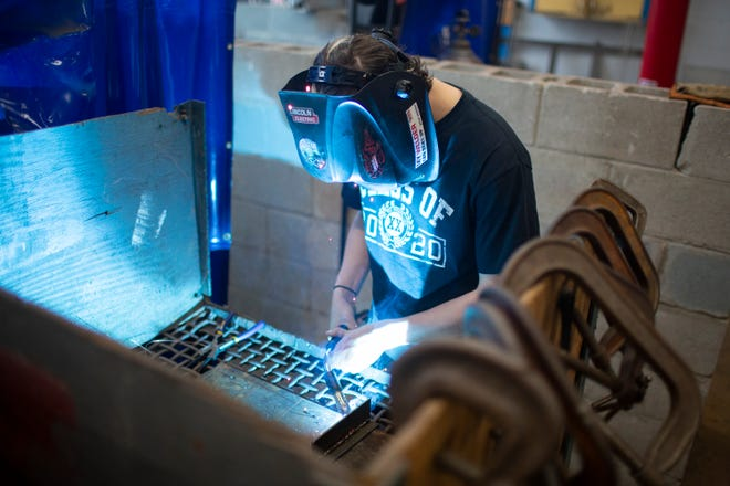 Mt. Pleasant High School senior Terry Sparks, 17, works on a welding project during a class at the high school on Thursday, Nov. 7, 2019. (Staff photo by Mike Christen)