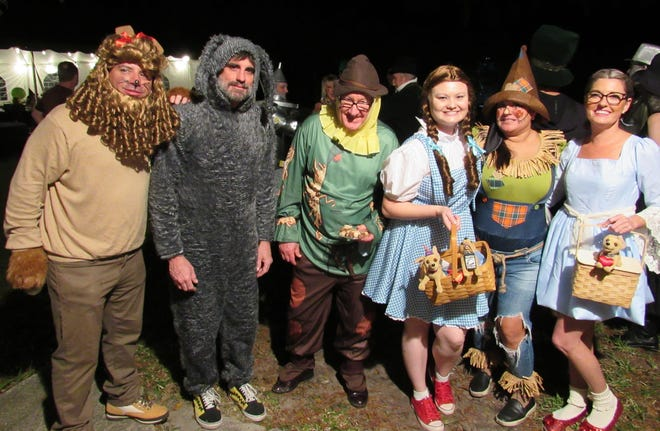 The gang's all here as guests mix and mingle in costume for the Wizard of Oz themed Josh Crews Writing Project Gala, hosted by the Flagler County Education Foundation on Nov. 6.