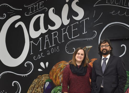 """Faith Kindig and Jonathan D'Silva, shown Nov. 29, 2018, were the co-founders of the Oasis Market, 914 State Street in Erie, Pennsylvania. They opened the store in February 2019 to provide downtown residents with access to fresh foods and other healthy foods, most of them produced locally. The store closed in October 2020, in part due to the COVID-19 pandemic. """"It is COVID-related,"""" said Kindig at the time, """"In that we just don't have foot traffic downtown right now."""""""
