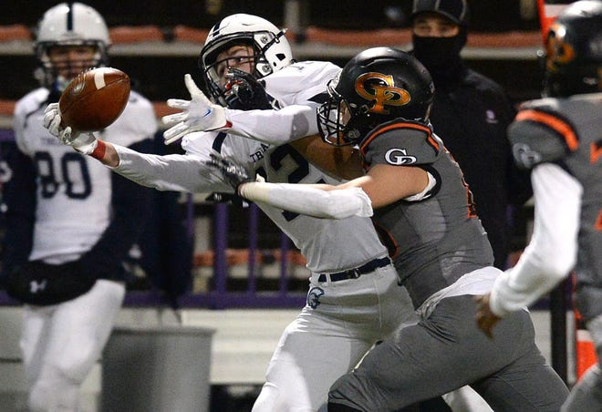McDowell receiver Braeden Soboleski hauls in a pass against Cathedral Prep's Andrew Roach on Oct. 30 at Erie's Veterans Stadium. McDowell and Cathedral Prep found out Friday that their PIAA quarterfinal opponents have forfeited because of COVID-19 outbreaks. Both Erie teams will advance to the state semifinals.
