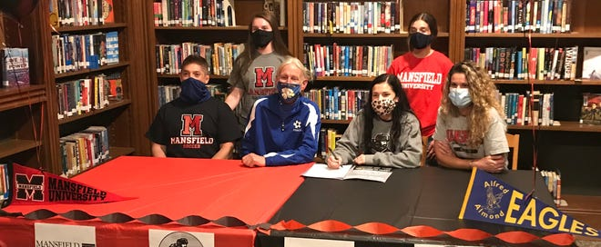 Emily Agnello, Midfield at Alfred Almond Central School District, signed her National Letter of Intent to continue her academic/athletic soccer career at Division II Mansfield University. Emily plans to major in Nursing. Pictured sitting left to right are Emily's father Marc, A-A girls soccer coach Jim Lucy, Emily and her mother, Kathleen Agnello. Standing are sisters Faith and Anna.