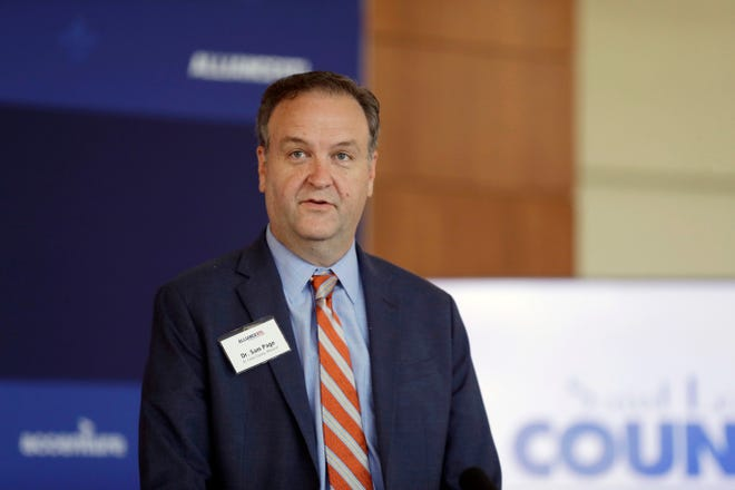In this June 23, 2020, file photo, St. Louis County Executive Sam Page speaks during a news conference in Town and Country, Mo. On Friday, Page announced strict new regulations that seek to slow the spread of COVID-19 as the number of cases is spiraling upward and hospitals are nearing capacity.