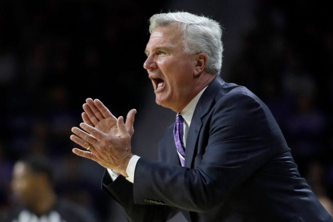 Kansas State head coach Bruce Weber applauds his team during the first half of a game against Texas last season. Weber lost his top three scorers from last season, when the Wildcats crashed back to 11 wins after three straight NCAA Tournament trips, and that means relying on a bunch of newcomers for their rebound effort.