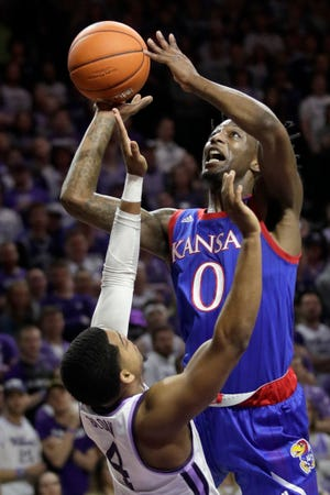 Kansas guard Marcus Garrett (0) shoots over Kansas State guard David Sloan (4) in a game last season. The Jayhawks will be challenged enough in the Big 12, where a double round-robin means two games each against four other ranked teams.