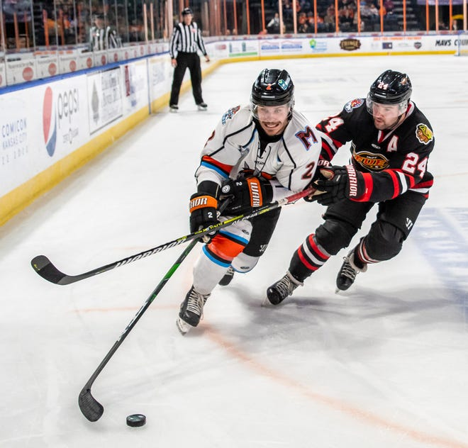 Kansas City Mavericks defenseman Zach Osburn tries to get around Indy Fuel forward Michael Doherty in a game last season. Osburn, who was named to the ECHL All-Star Game in his rookie season, has re-signed with the Mavericks for the 2020-21 season.