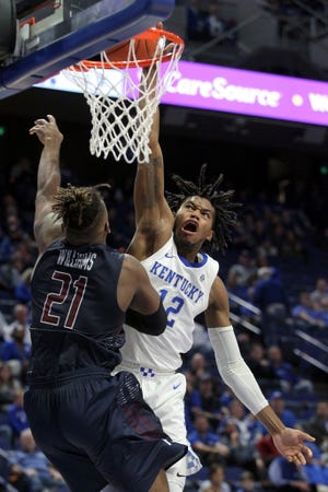 Kentucky's Keion Brooks Jr. (12) dunks over Fairleigh Dickinson's Elyjah Williams (21) in a game last season. The No. 10 Wildcats lost five starters among nine departures from last season, including Southeastern Conference Player of the Year Immanuel Quickley and All-SEC first teamer Nick Richards. That left Brooks, a sophomore forward, as the lone returning regular after starting six of 31 games.