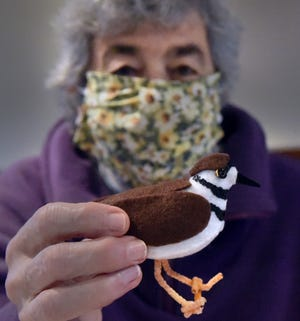 St. George's Episcopol Church in Durham is having its annual homemade felt bird sale. This year's killdeer is held by Penny Hardy, who helped start the fundraiser tradition in 1979.