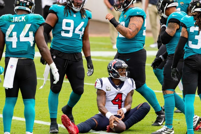 Houston Texans quarterback Deshaun Watson (4) is surrounded by Jaguars players during the second quarter of Sunday's game at TIAA Bank Field. Matt Pendleton/Special to the Times-Union