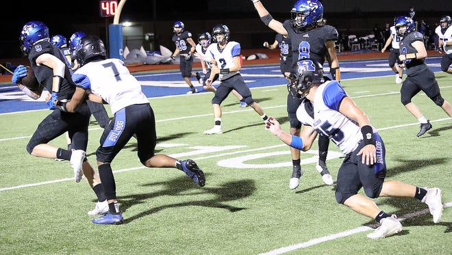 Gunter's Cole Lemons returns an interception for a touchdown in the Tigers' bi-district win over Rice at Rains. Lemons picked off three passes and returned two for scores.