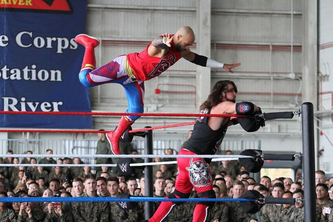 A.J. Styles and Trevor Mann perform during WWE's 17th Annual Tribute to the Troops event held at Marine Corps Air Station New River on Dec. 6, 2019.