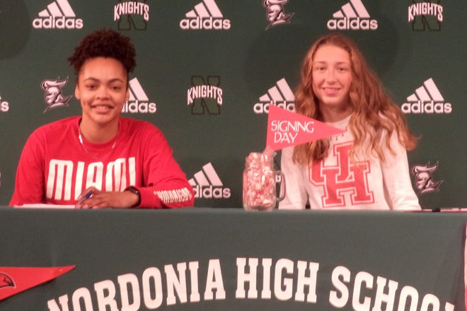 Nordonia seniors Madi Cluse, left, and Sam Wiehe signed their national letters of intent Nov. 13 at Nordonia. Cluse will play basketball at Miami University, while Wiehe will play soccer at the Unviersity of Houston.