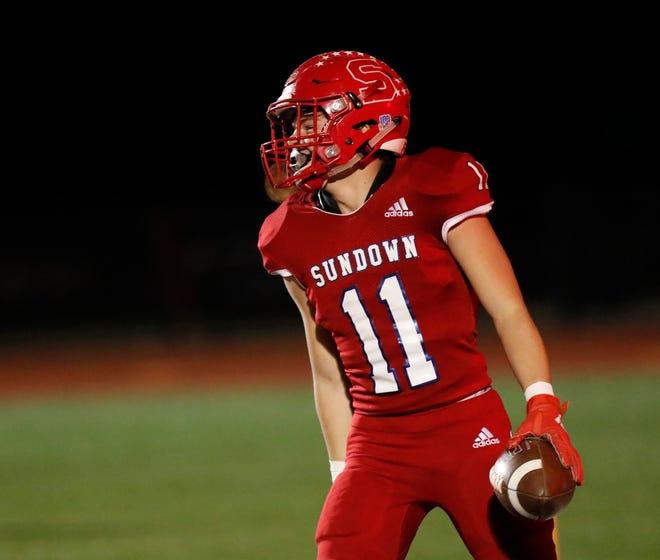 Sundown's Carson Boggs celebrates a touchdown during a Class 2A Division I bi-district game Nov. 12 against Farwell at Lobo Stadium in Levelland.