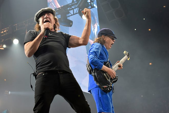 """Brian Johnson, left, and Angus Young, of AC/DC, perform on the Rock or Bust Tour on Feb. 17, 2016, in Chicago.  After 47 years, the band released its 17th studio album, """"Power Up,"""" on Friday."""