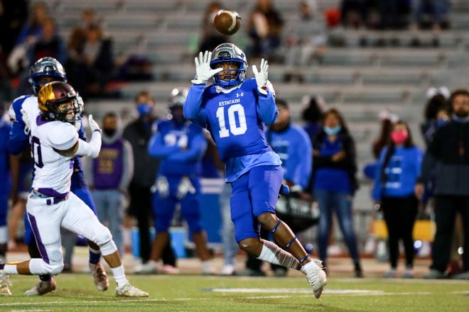 Estacado's TJ Steele (10) attempts to catch a pass against a Pecos defender during a Class 4A Division II game Thursday, Nov. 12, 2020, at PlainsCapital Park at Lowrey Field.